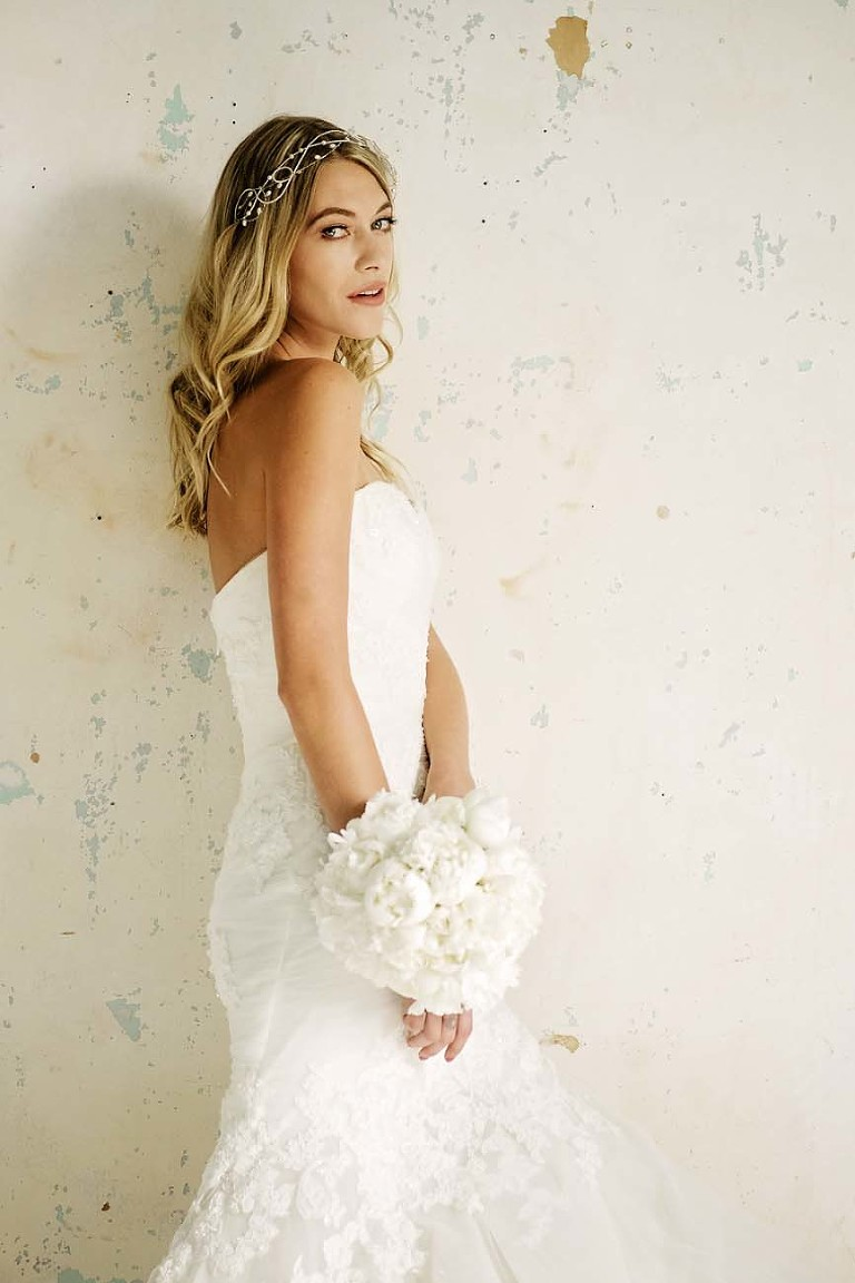 Dani wearing an Enzoani Wedding Dress