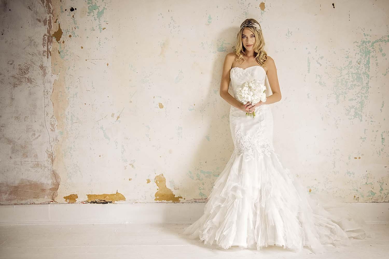 Dani wearing an Enzoani Wedding Dress